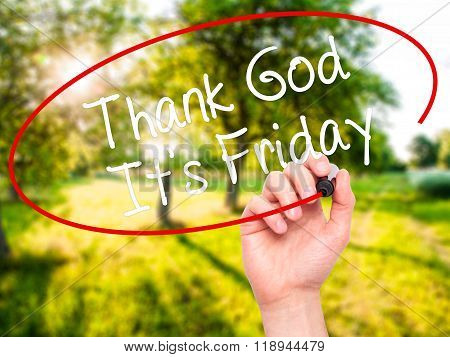 Man Hand Writing Thank God It's Friday With Black Marker On Visual Screen