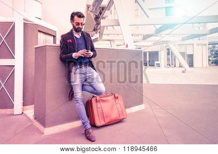 Happy Young Man With Smartphone - Fashion Hipster Guy Using Mobile Phone In Urban City Area