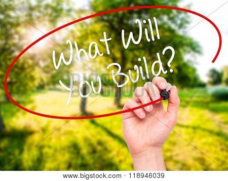 Man Hand Writing What Will You Build? With Black Marker On Visual Screen