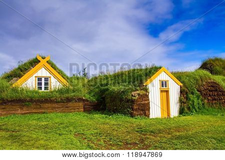 The reconstituted village - museum of the first settlers. Roofs of houses covered with turf and grass. The village ancestors in Iceland