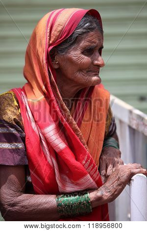 Pune, India - July 11, 2015: A Portrait Of An Old Indian Woman Who Is A Hindu Pilgrim, During The Fa