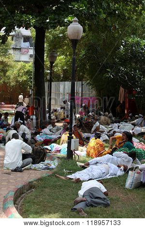 Pune, India - July 11, 2015: Indian Pilgrims Called Warkaris Resting In A Garden During Afternoon, D