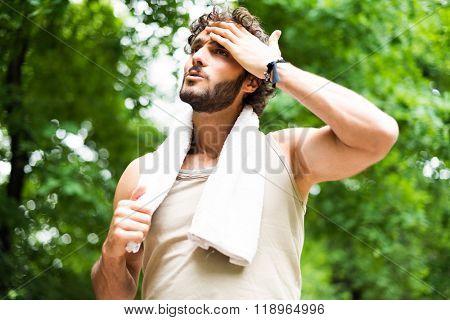 Man sweating after a session of training in a park