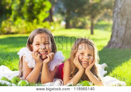 Happy Smiling Children Playing On Family Picnic
