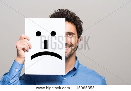 Conceptual image of a man changing his mood