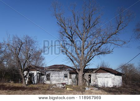 A Wide View of a Rural Texas Residence Falling Into Decay