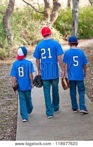 Portrait Of Three Baseball Boys Walking