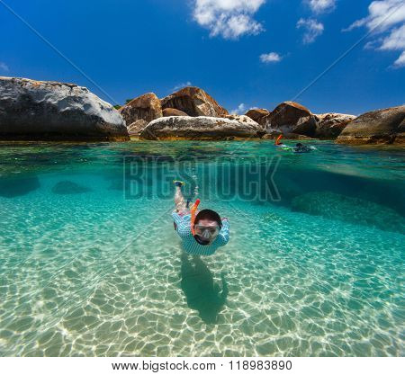 Split photo of young woman snorkeling in turquoise ocean water granite boulders on Virgin Gorda, British Virgin Islands, Caribbean