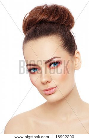 Young beautiful healthy woman with stylish make-up and hair bun over white background, copy space