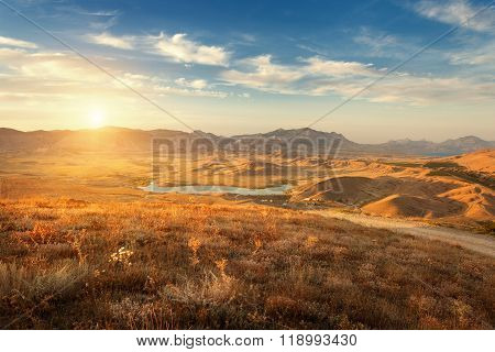 Beautiful View At The Mountain Valley At Sunset In Summer
