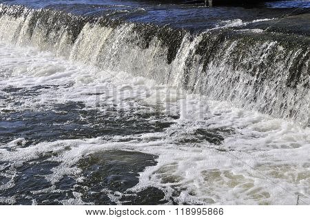 Waterfall on the river. Groyne hydraulic structure of on the river Ros.