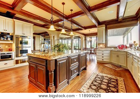 Great Kitchen With Hardwood Floor And Nice Counter Tops.