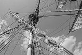 Mast with sails of an old sailing vessel black and white photo poster