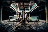 Dramatic view of damaged escalators in abandoned building. Apocalyptic and evil concept poster