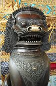 Lion statue in traditional Thai style at Wat Phra Kaew poster