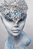Mannequin in creative silver snow queen crown on grey background poster
