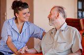 elderly man with nurse carer or granddaughter. poster