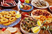 Tapas from spain varied mix of most popular tapa mediterranean food poster