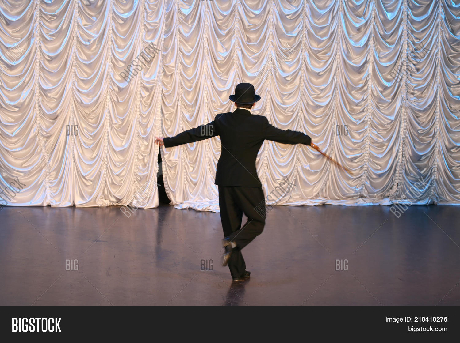 ded36ebe2103 Tap dance with a cane in a black hat. Dance step. A man is