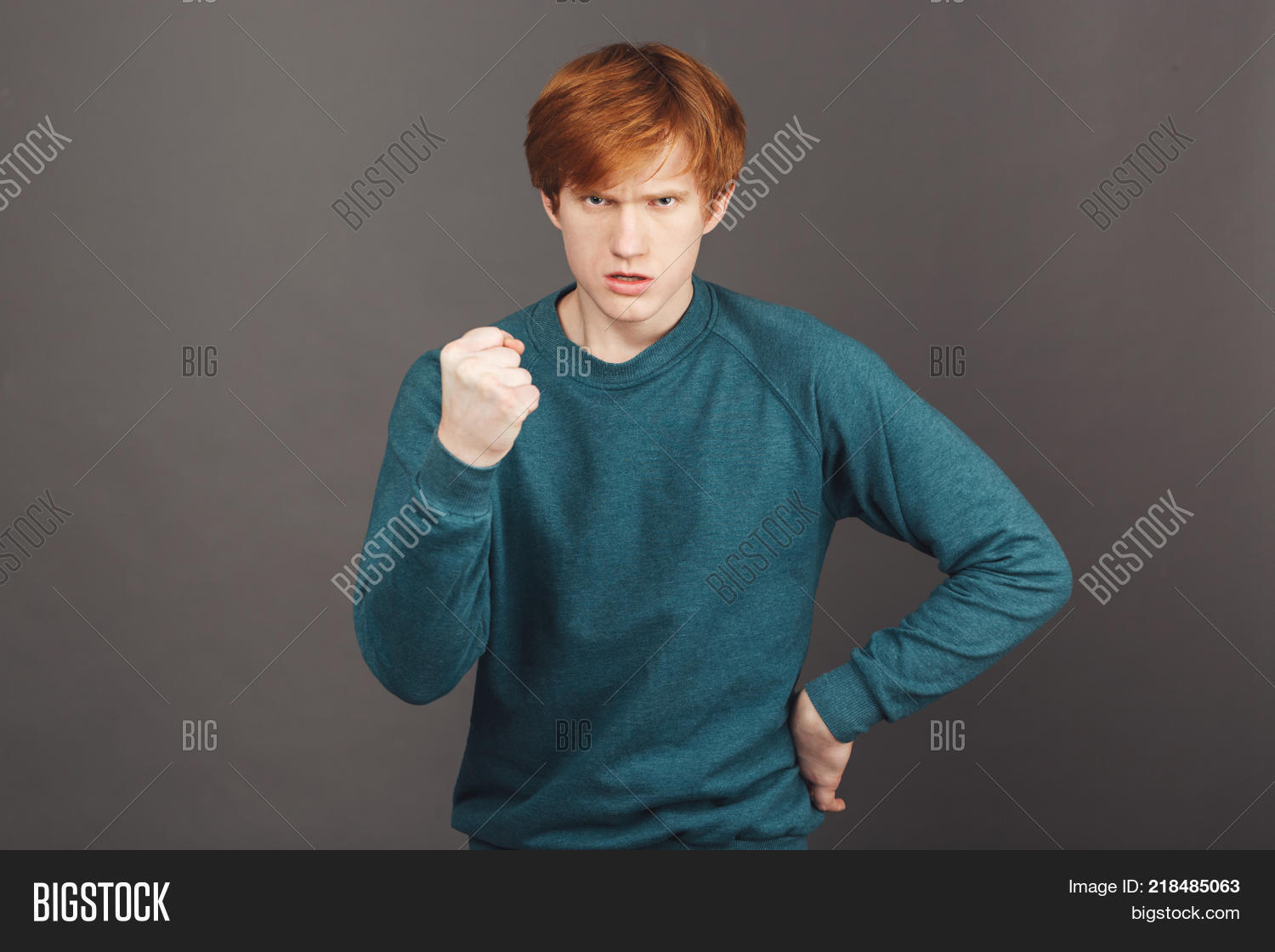 Young Attractive Mean Ginger Young European Student Guy In Green Sweater