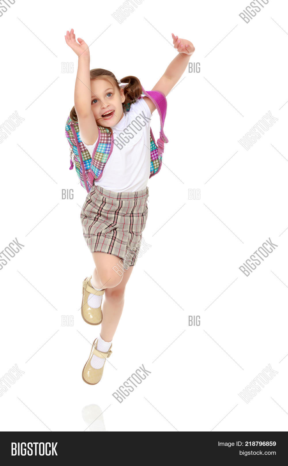 b21c21499 Little Girl Jumping Image   Photo (Free Trial)