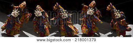 Ancient ritual dance of Buddhist lamas in Masks, photo panorama.