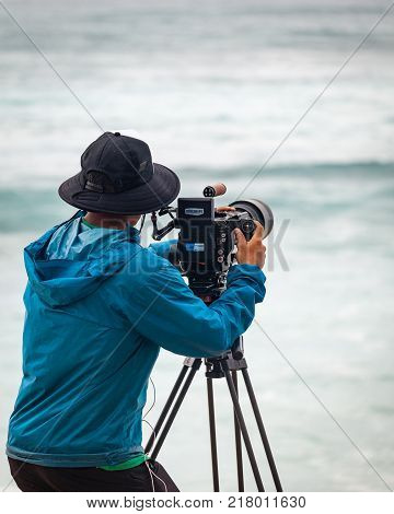 SUNSET BEACH HAWAII USA - DECEMBER 2, 2017: Videographer at the 2017 Vans World Cup of Surfing competition at Sunset Beach on Oahu's scenic North Shore. This is the second of three surfing competitions and Conner Coffin took first place.