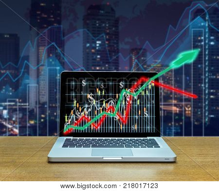 Stock exchange market trading graph over the screen of computer laptop on wood table over the photo blurred of trading graph background business marketing trade concept, 3D illustration