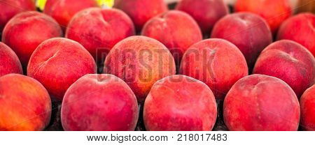 Organic fresh ripe peaches a local farmer market. Healthy local food market concept.