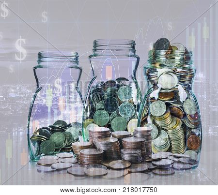 Double exposure of stack of coins and mix coins in clear bottle on blurred photo of cityscape and financial graph with cityscape background Business Trading and investing concept, 3D illustration