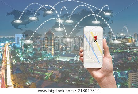 female hands holding a smart phone showing part of navigator map over screen on connection line over the world map with cityscape Navigation conceptElements of this image furnished , 3D illustration