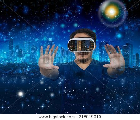 Double exposure of Asian man wearing virtual reality showing the building cityscape over star with the earth and cityscape background Elements of this image furnished VR concept, 3D illustration
