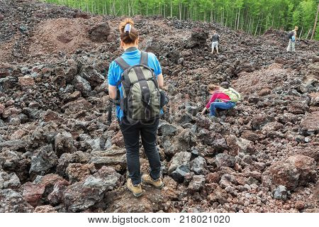 Kamchatka Peninsula, Russia - August 20, 2016: Tourists on the North Breakthrough Great Tolbachik Fissure Eruption in the Kamchatka