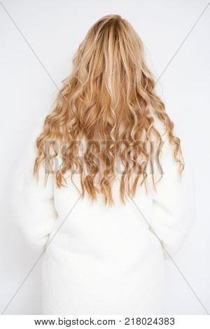 Female Long wavy blonde hair, rear view