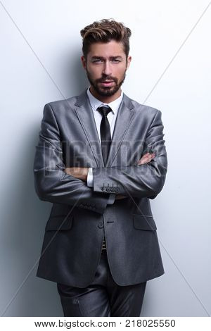 young businessman posing with crossed arms.