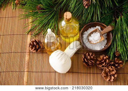 Spa treatment with Christmas decorations on mat background