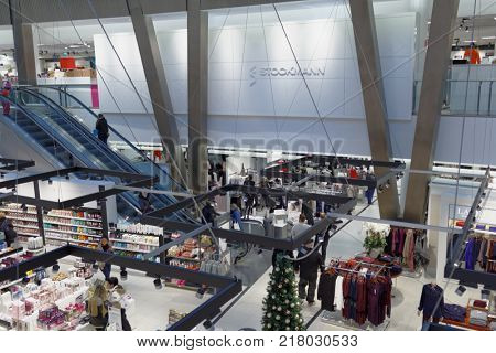 HELSINKI, FINLAND - DECEMBER 9, 2017: People on the Christmas market of Stockmann department store in Itis shopping center. Since 2001, this mall is the largest shopping centre in the Nordic countries