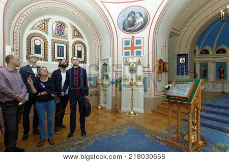 ST. PETERSBURG, RUSSIA - AUGUST 30, 2017: People in the Home Church of Yusupov palace. The palace is acclaimed as the Encyclopedia of St. Petersburg aristocratic interior