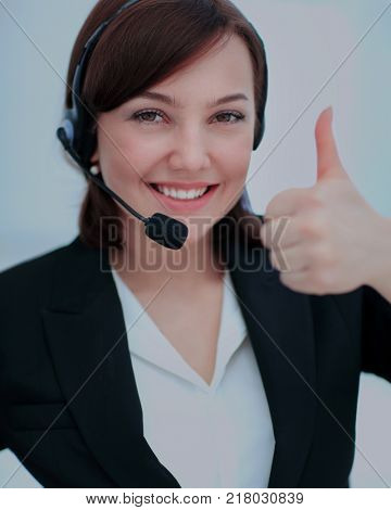 Beautiful woman working at callcenter, using headset showing thu