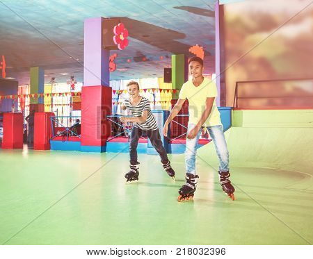 Teenage boys at roller skating rink