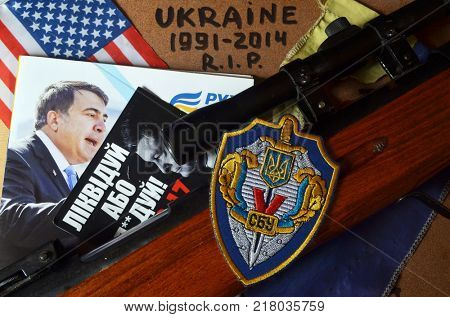 ILLUSTRATIVE EDITORIAL.Chevron of Ukrainian pro-american Security Service of Ukraine, the SBU.Back: Political program Mikhail Saakashvili.Sticker Pork - go away (UKR). Kiev,Ukraine December 11 ,2017