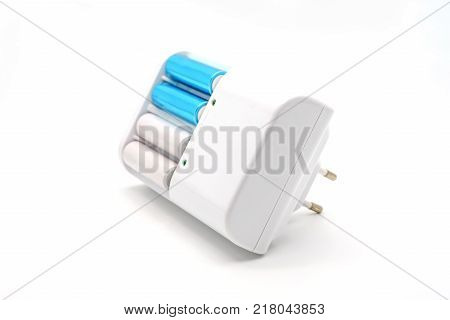 AA batteries rechargeable in accumulator charger isolated on a white background