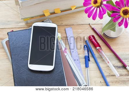 all book with notebook memo for study on table