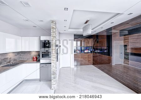 Interior of the kitchen-living room in a modern house.