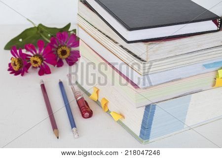 all book with notebook for memo study on table white