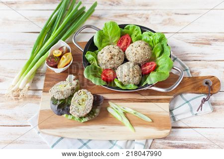 Dietary cutlets cooked in the oven with broccoli served with rissole. On old wooden white background.