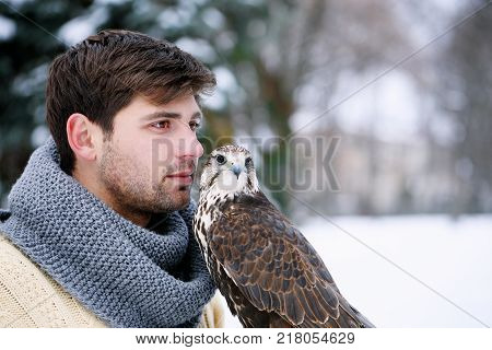 Portrait of a man with a feathered pet