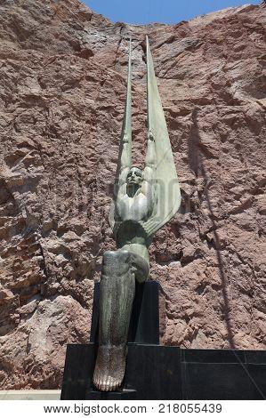 NEVADA, USA - June 30, 2017: Metal Statue at the Hoover Dam. The Hoover Dam is at the Stateline of Nevada and Arizona