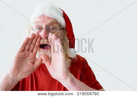Portrait of shouting Santa Claus. Aged man cupping hands and shouting. Santa Claus making announcement