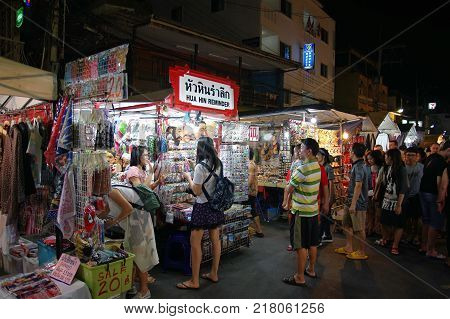 HUA HIN THAILAND - 9 DEC 2017: Unidentified Tourists shopping at Hua Hin night market. Here is the biggest night market and very famous for foreign and Thai visitors.